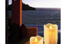 Flameless Candles / This is LED electronic candle lights, it is very likely to real candle, but it use LED as lights source. It would never be used out, and you would never have to worry about the fire. And you would never have to change the lights source. They look very beautiful and romantic.