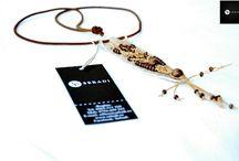 Pandantive unicate / Producator de accesorii unicate din piele, lucrate manual. Pentru informatii si comenzi sunati numarul:  0756-699 225 - orange