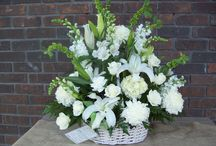 Funeral baskets and urns / funeral baskets- one sided wicker (for home) or plastic (for ooutside) or urn style for churches