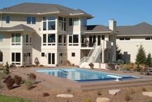 PPS's In ground Pools / Collection of our own custom  in ground swimming pools. Collection includes custom landscaping, fencing and concrete. Contact us for more information about designing your backyard oasis!   http://www.performancepools.com/contact-us
