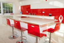 Alabaster Gloss Kitchen with Red Accessories / Second Nature Gloss Alabaster, red glass and accessories and Silestone worktops. Designed Supplied and Installed by KITCHENCRAFT Witham, Essex