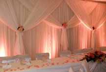 Draped Backdrop / Draped Backdrop Hire (see picture) - different sizes available - Unlike our competitors we steam all our backdrops on site to remove all the creases. We have lots of different backdrops available to hire from fairy light backdrops & starlight backdrops, to uplit & panel backdrops.
