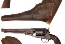 antique revolvers and their holsters / packing iron......