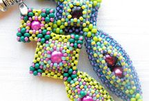 Beaded pendants and brooch