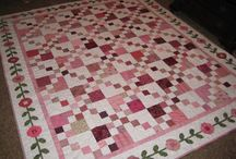 Pink Quilts / I am thinking towards October and Breast Cancer Awareness Month and I thought I would go find Pink Quilts and get inspired.