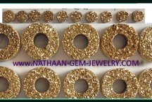 Gold Drusy gemstones  / What Is Golden Drusy and Druzy? A druzy, whether it's golden or not, is the term that refers to a blanket of tiny, sparkling crystals often found inside a geode or an agate. The sparkling appearance of druzy (or, more commonly, drusy) is like that of spilled salt or sugar. Sources: http://nathaan-gem-jewelry.com/