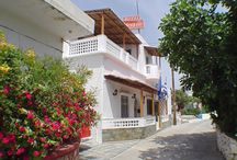 "Semiramis Guesthouse / Hotel Semiramis is a hospitable, family-run hotel in a quiet neighborhood of Adamas, the most beautiful village of Milos island, conveniently located close to the village center. Semiramis Hotel stands in a beautiful vine-covered garden, a short walk (just 100 meters) from the central village square, 200 meters from the water, 300 meters from the Adamas seaport, and about 500 meters from the ""Blue-FlAG Papikinos beach."