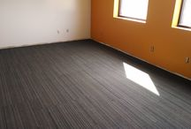 Canvas Craft / A growing manufacturer needed flooring in a new space. They chose a durable carpet tile installed in a monolithic pattern.