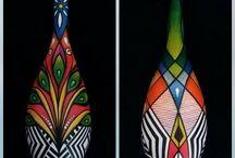 """Série """"ETNIAS - Entre o Céu e as Águas"""" / Entre o céu e as águas, encontramos uma rica diversidade cultural das várias tribos existentes em nossas exuberantes matas. Nesse contexto, trabalhei as pinturas corporais dos índios num diálogo mais direto com os pássaros e os peixes, representando, a perfeita harmonia e cumplicidade entre o ser humano e a natureza, como numa simbiose, onde as cores completam a riqueza e diversidade de nossas florestas e raízes."""