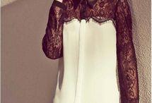 Блузки.