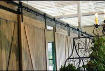 Gigantic barn door installation at Atrium Weddings & Events / Atrium Weddings & Events has a gigantic installation of Goldberg Brothers barn door hardware in their beautiful facility.