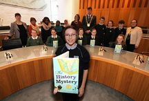 Battle of the Book / From the end of January, five schools in the Fingal area have put their fifth class students out to battle one another – not with pointy spears but with knowledge! Over the next couple of months, these two hundred students will read The History Mystery by Ana Maria Machado and come together for a giant quiz in May.