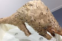 Pangolins / Two pangolin sculptures made from recycled cardboard by the artist Jacha Potgieter. On display at The Platform Galeri in Betws-y-Coed, North Wales.
