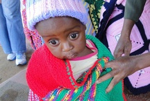 Knit-a-square / Knit a square and help wrap a blanket around a cold child orphaned or made vulnerable by HIV AIDS and poverty in southern Africa.