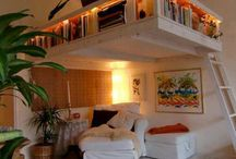 Bed room with books and mezzanine