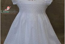 hand smocked baby dresses in white