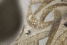 Design: Our Couture Fabrics / Our Couture Collection of hand embroidered couture fabrics is now recognised as a collection of unique textiles of unequalled quality. These extraordinary fabrics are hand embroidered, using fine coloured silks, with gold and silver threads.  Some are embellished with pearls and crystals, others inlaid with semi-precious stones, but each is a work of art.