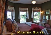 Master Suite / The Master Suite includes a private sitting room, fireplace, foyer, king bedroom, en-suite bathroom, flat screen TV/DVD and awe-inspiring views!
