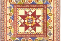 Quilts I Love / This quilt is all done with batiks from Hoffman Distributors and was custom quilted.  $96.95