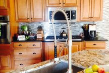 Kitchens with a splash of glass / These are some of our glass tile kitchen installation photos.