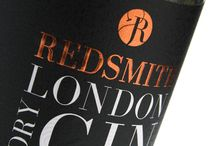 Redsmith London Dry Gin / Manufactured by Royston on a combination press, the label was printed on a textured black material and boasts embossed hot foil branding. The rich copper red used here features again on the inside of the label, where the Redsmith logo is set against a lively pattern of monochrome circles. This striking background swirls and swells with the movement of the liquid, creating a truly unique visual effect.