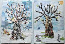 Bomen in de winter gemaakt van oude kranten.