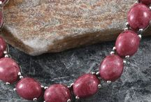Thulite / Known for being a stone of nuturing and believed to aid understanding, Thulite is beautiful stone which holds a stunnign pink/red hue. Discover something you love in our collection...