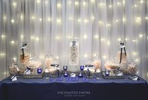 Navy 21st Candy Buffet / To celebrate a sentimental and milestone moment, our client wanted a bold + strong theme to this masculine Candy Buffet. Playing on the simplistic navy striped pattern and framed by a warm white fairy light backdrop with navy crushed taffeta linen, set the scene for this delicious feature. It was certainly a talking point for guests to enjoy and a great interactive element for this landmark occasion. Youtube: https://www.youtube.com/watch?v=jfTdxlo5k-s