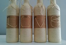 Recycled wine bottles wrapped with twine / Can be used as any Centre piece in your Home. I Love It!!!!