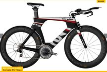 Triathlon Bikes / A triathlon bike is the type of bike designed majorly for ridding comfortably as well as efficiently while you are in aerodynamic posture with the elbow resting kind of aero handlebars.
