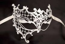 Venetian masked ball masks in White / Just Posh Masks selection of White Venetian Masquerade Masks for a Masked Ball. Masks for men and women all decorated, predominately, with white tones, trimmed with pearl white, gold or silver glitters, available with or without feathers