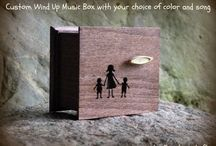 WIND UP MUSIC BOXES / These music boxes can have the wind up key on the top or the bottom of the wooden box! You need to wind the key up first, then let it go and the music box will play the song over and over (for about 2 minutes)! These wind up music boxes are permanently sealed shut if the wind up key is on the top! If we put the wind up key to the bottom of the music box and the box itself stands on cute little feet, you can have an open lid as well!