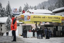 Saving the Arctic at World Economic Forum, Davos / 25 activists from across Europe shut down a Shell petrol station near the World Economic Forum in Davos, in protest against the company's reckless Arctic drilling program. Activists from Germany, Switzerland, France and Italy, wander in Davos dressed like polar bears, chain themselves to fuel pumps and block the station placing three tonnes of ice on the ground. Have a look! / by Greenpeace
