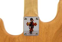 Custom Guitar Neckplates by AxetremeCreations / Customguitarneckplates.com  offers a unique range of neckplates. Search our color, engraved and stamped options. Follow us to see what new designs are coming or challenge us to create something unique for you.