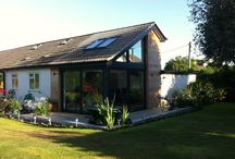 Craig Y Don / A kitchen / Sun room extension to a 1970s bungalow on Anglesey, North Wales