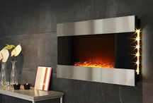 Electric Fireplaces / Cold weather. Warm home. Electric fireplaces are an ideal way to warm your family with no gas use, no harmful carcinogens, no wood-chopping and stacking, Multiple heat settings and romantic ambiance with no effort!