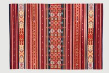 Synthetic rugs / Our design style can be described as eclectic, vintage-inspired and proudly African.  Jacquard-woven rugs: 50% Acrylic, 40% Polyester, 10% Cotton.  Viscose rugs: 100% viscose.