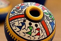 Painting miniature pots with indian design