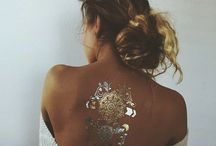 Body decor / Rings; necklaces; tattoos