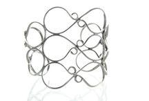 Silver Cuffs / by Majestical