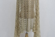 Assuit (tally) / Assuit cloth is a cotton mesh fabric embroidered with hammered metal strips. The metal is wrapped around the mesh, and the ends are hammered under to hold the piece in place.  It is named for the Assuit region of Egypt, where it originated, and also known as Tally.