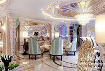 Дизайн интерьера квартиры в стиле Ар Деко в ЖК Кутузовская Ривьера / Дизайн интерьера выполнен для квартиры в ЖК «Кутузовская Ривьера». За основу взято направление Ар-Деко. Благодаря этому квартира выглядит изыскано, стильно и дорого. В гостиной комнате большие окна и много зеркальных элементов декора и люстр. Это наполняет дом светом, и визуально увеличивает пространство.