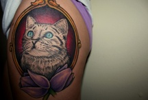 Give me tattoos. / by Emily Savill