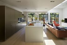 Kitchen Architecture bulthaup case Study : Urban Open Plan Living / Kitchen Architecture – bulthaup b3 furniture in sand-beige aluminium and kaolin laminate with glass splash back and 10 mm stainless steel work surface.