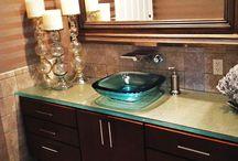 Glass Vanities / These beautiful vanities incorporate our glass countertops into a bathroom vanity or sink.