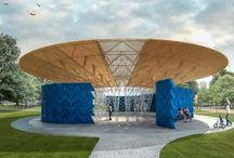 2017 Serpentine Pavilion / Inspired by the large canopy of a tree, Kéré's pavilion rests on fourteen legs, an oval canopy of cantilevered steel rising and spreading outwards. Roof panels of slatted wood cast shade and a series of curved wall sections provide shelter but offer glimpses of sky and the park beyond.