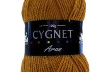 Cygnet Aran / Cygnet Aran is a very popular part of the Cygnet range.  There is a lovely choice of traditional shades, making it ideal for sweaters, cardigans, cable knits, blankets etc.  The Cygnet Aran is very economical as it comes in a 100g ball format, so unlike a lot of Aran wool that is only available in large 400g balls, these are ideal for smaller projects.  It is machine washable.
