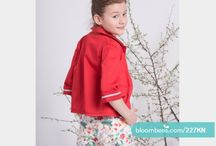 Bloombees / Red jacket Length: to the hip Fashion: a simple jacket with 3/4 sleeves with trimming at the edges.  Pockets finished with colored trimming. Fastened with decorative buttons. Fabric: 97% cotton, 3% elastane Made in Poland