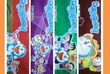 Platik kemasan es krim stik doraemon Rahma es krim 0852-1042-3883 / Menyediakan kemasan plastik es krim stik Doraemon   ukuran 18x6,5cm