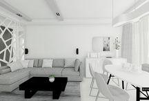 """Monochromatyczne wnętrza mieszkania w Warszawie / Podstawą projektu wnętrz mieszkania w Warszawie jest rezygnacja z żywych kolorów we własnej przestrzeni życiowej. Stawiamy na biel, grafit, szarość w przemyślanych proporcjach oraz nieszablonowej kompozycji: szary narożnik zachęcający do odpoczynku, betonowe białe panele ścienne, biała kuchnia ze szkłem, funkcjonalna zabudowa garderoby oraz kropka nad """"i"""", czyli designerska oryginalna lampa nad stołem. Ma być minimalistycznie i komfortowo, a biel uspokaja emocjonalnie, pozwala odpocząć."""
